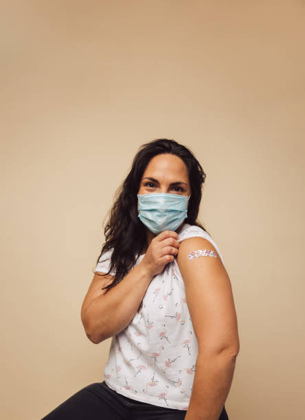 Mature female received vaccine stock photo