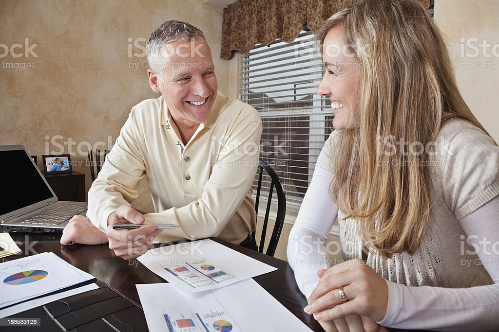 Mature Financial Advisor Working With Young Woman stock photo