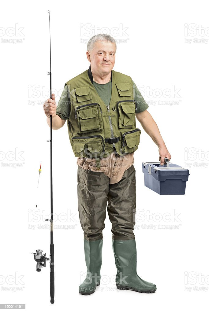 Mature fisherman holding a fishing equipment stock photo
