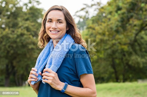 825083304 istock photo Mature fitness woman smiling 658600206