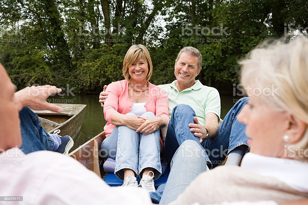 Mature friends on a boat trip royalty-free stock photo