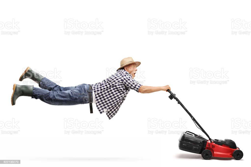Mature gardener being pulled by a lawn-mower stock photo