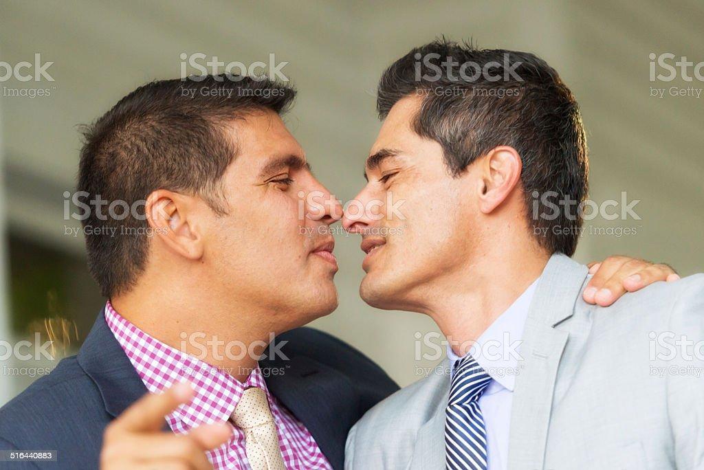 Mature men kissing
