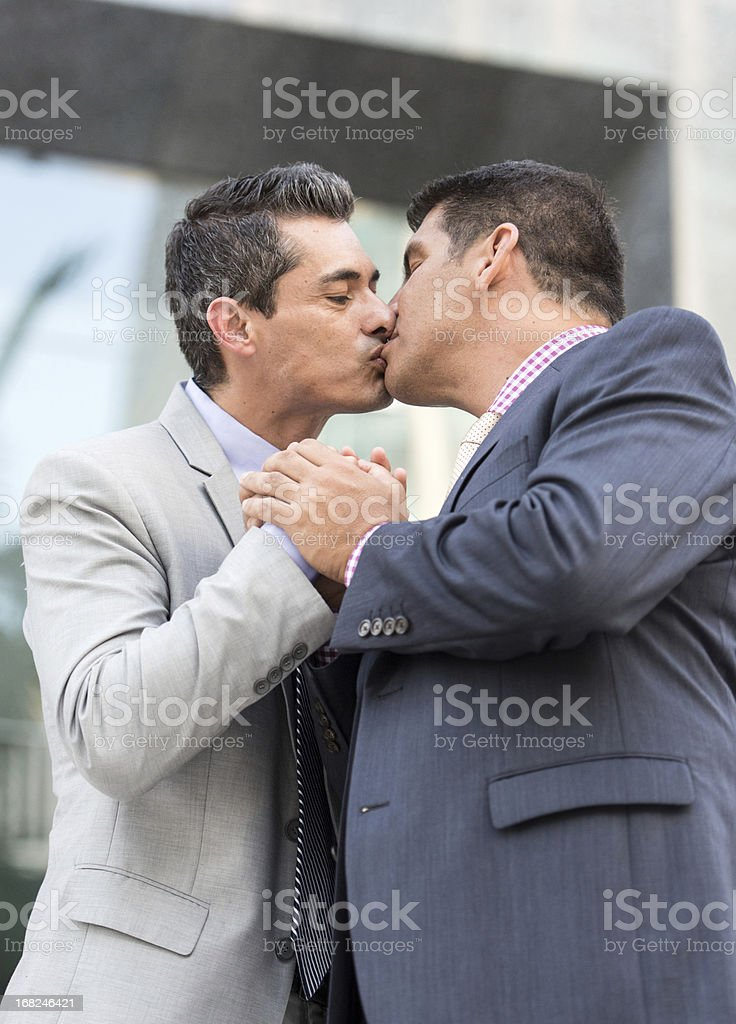 Mature gay men kissing
