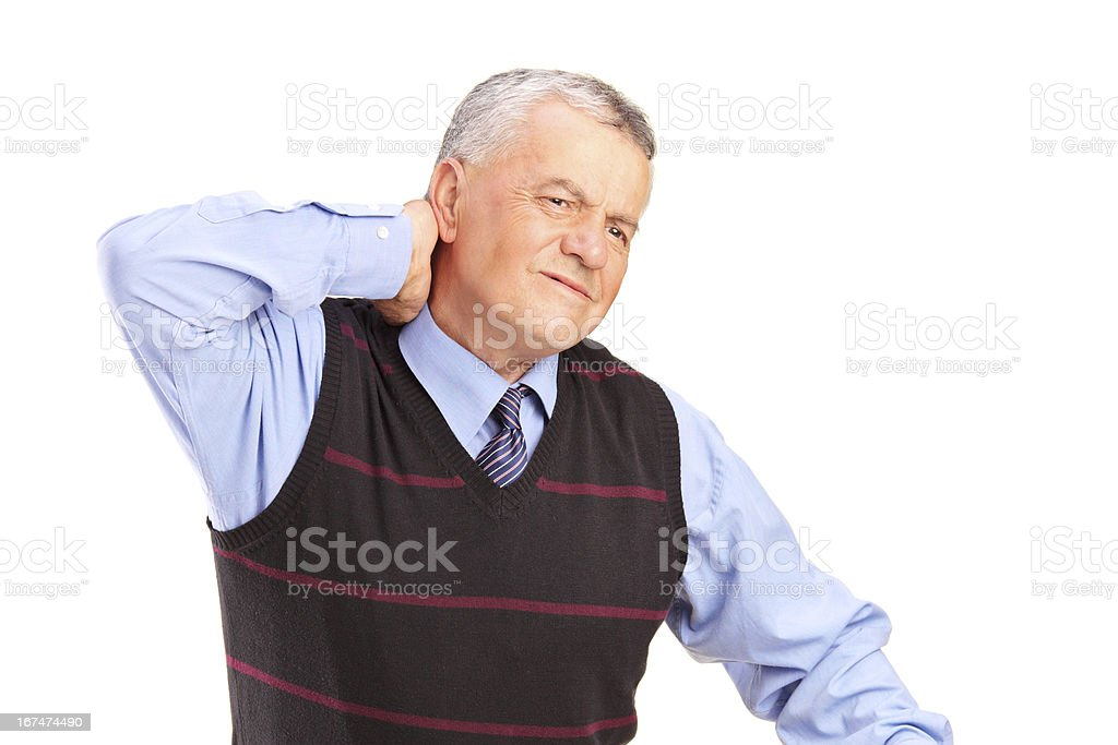 Mature gentleman suffering from a neck pain royalty-free stock photo