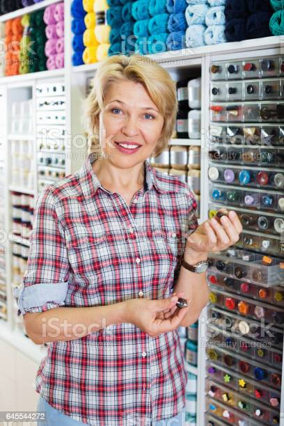 Mature glad woman customer picking various buttons picture id645544272?b=1&k=6&m=645544272&s=612x612&h=djogfa0z4j3ltxnwnzejtkq2tbfqqfxwni2bsoa3h4k=