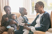 istock Mature grandparents at home looking after grandchildren 907956282