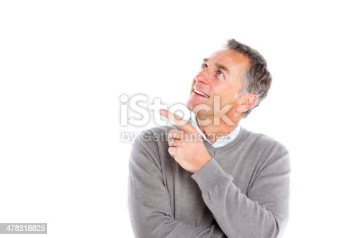 istock Mature guy looking up and pointing at copyspace 478318625