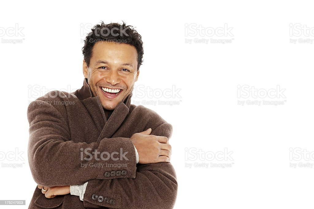 Mature guy wearing winter coat smiling against white royalty-free stock photo