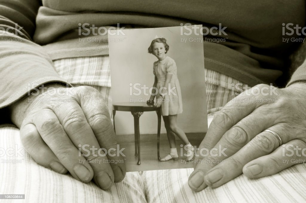 Mature Hands Holding Old Photograph royalty-free stock photo