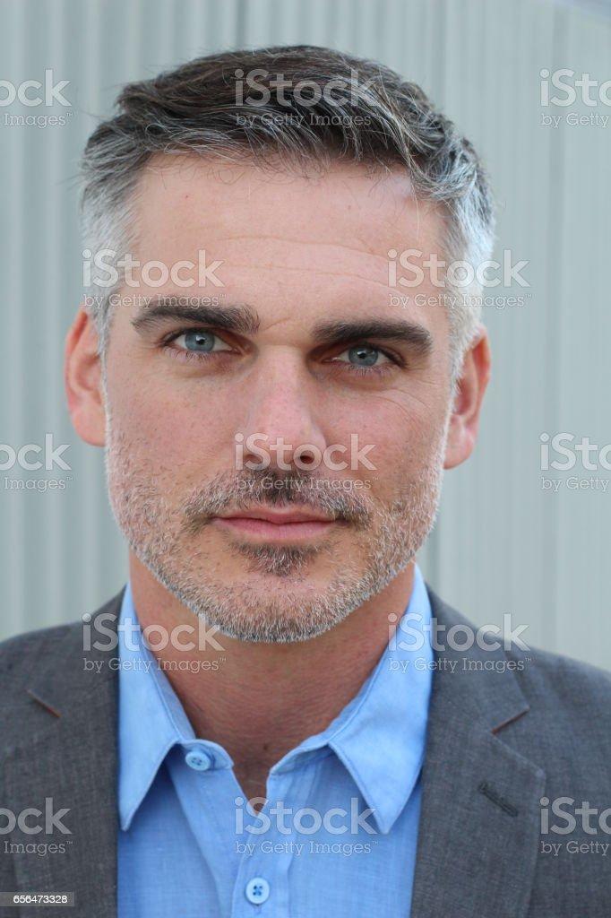 Mature handsome Caucasian businessman smiling stock photo