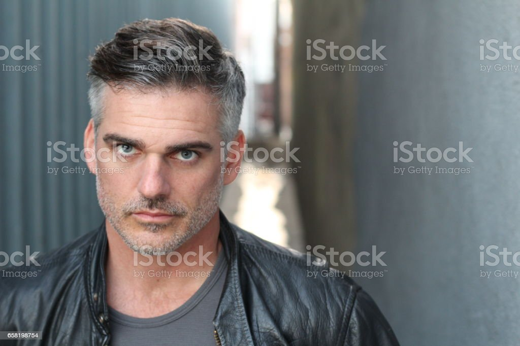 Mature handsome Caucasian man with gray hair stock photo