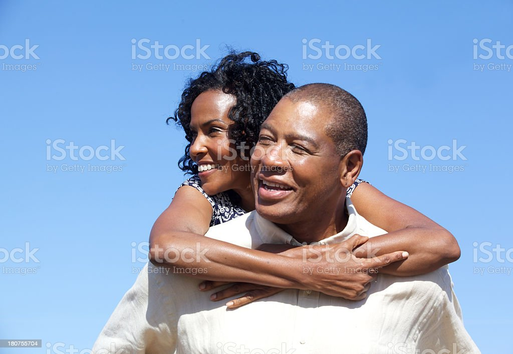 Mature Happy Afrian American Couple Against a Blue Sky royalty-free stock photo