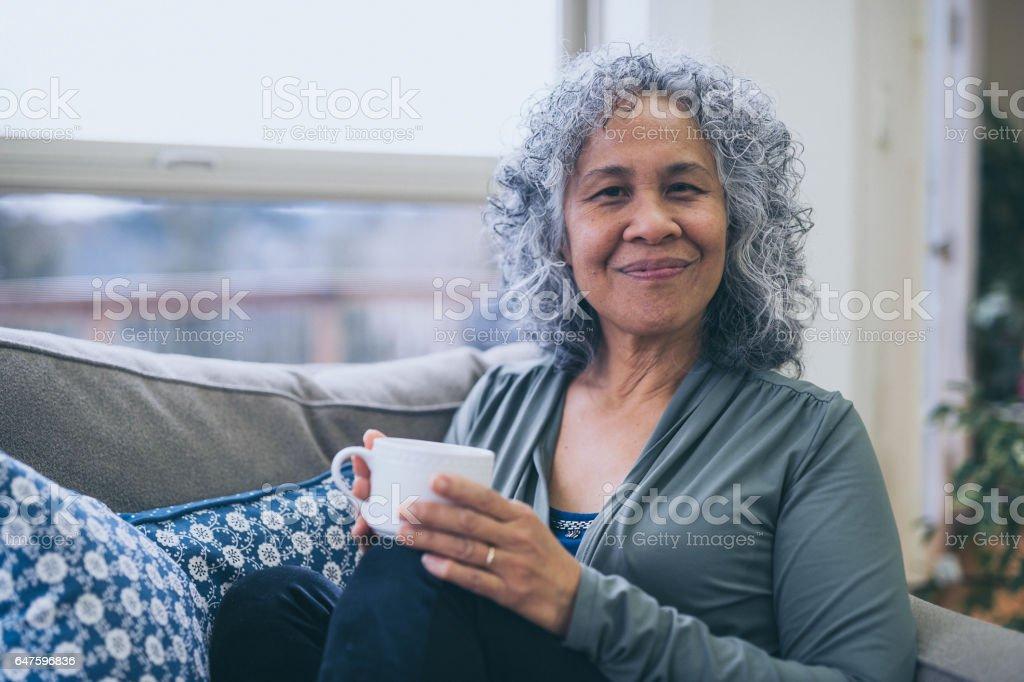Mature Hawaiian Woman Drinking Tea In The Morning By