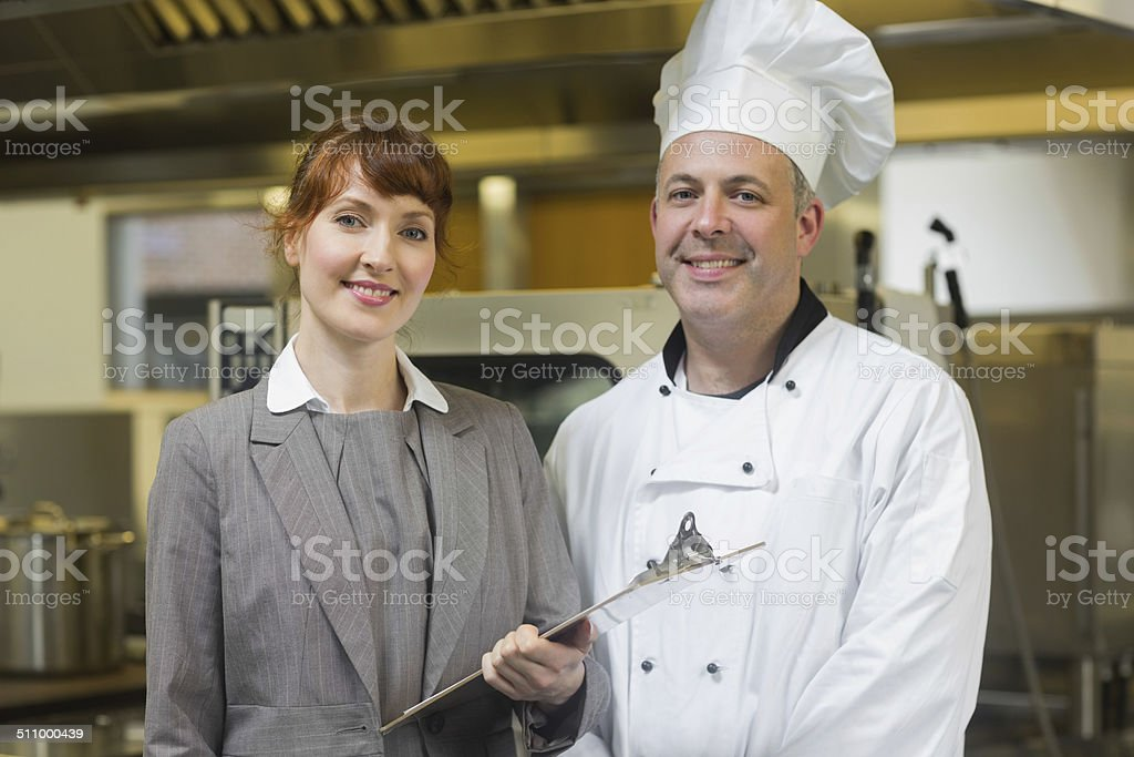 Mature head cook posing with the female manager stock photo