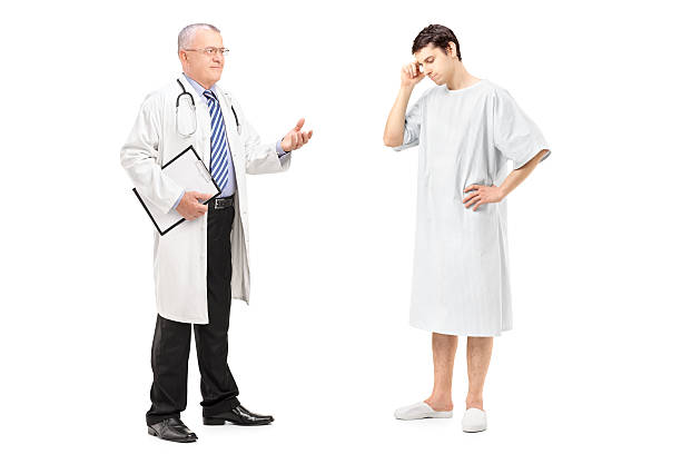 mature health specialist talking to a worried patient - hospital studio bildbanksfoton och bilder
