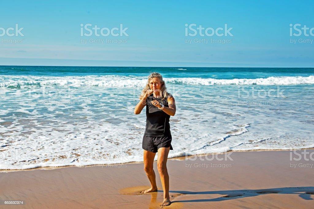 Mature healthty woman exercising shadow boxing stock photo
