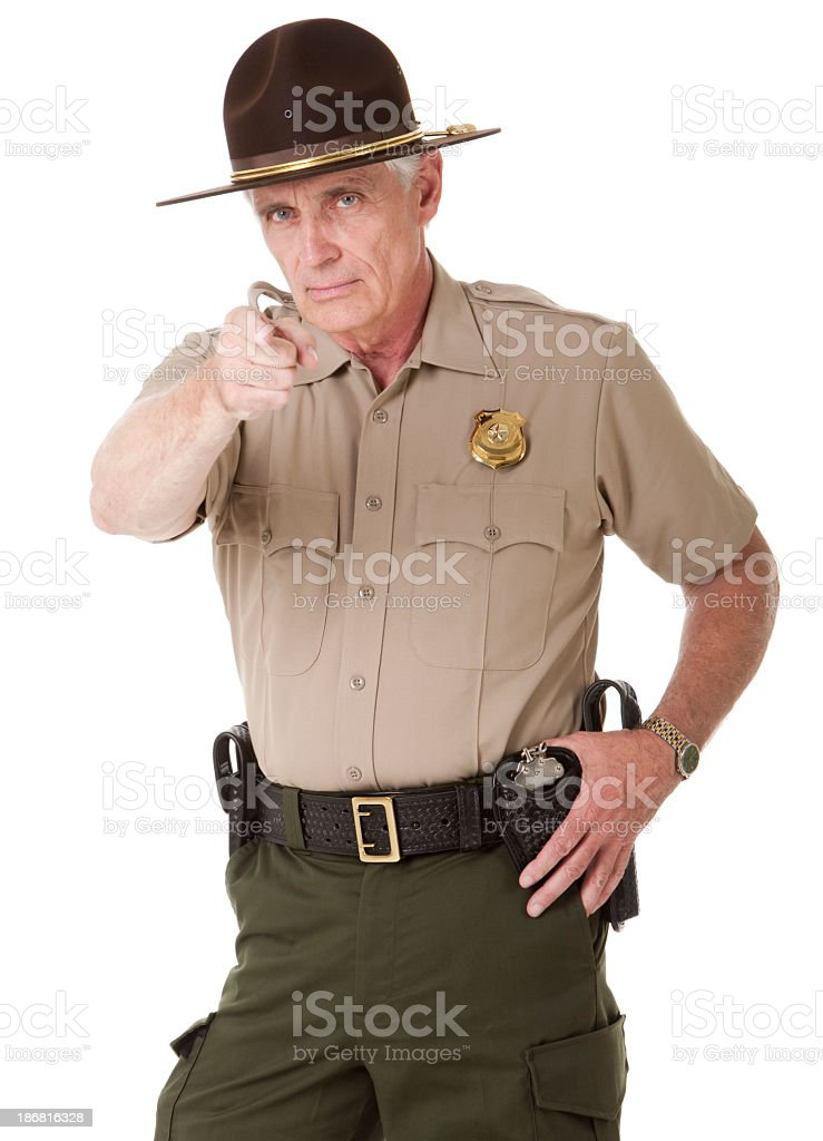Mature Highway Patrolman Pointing stock photo