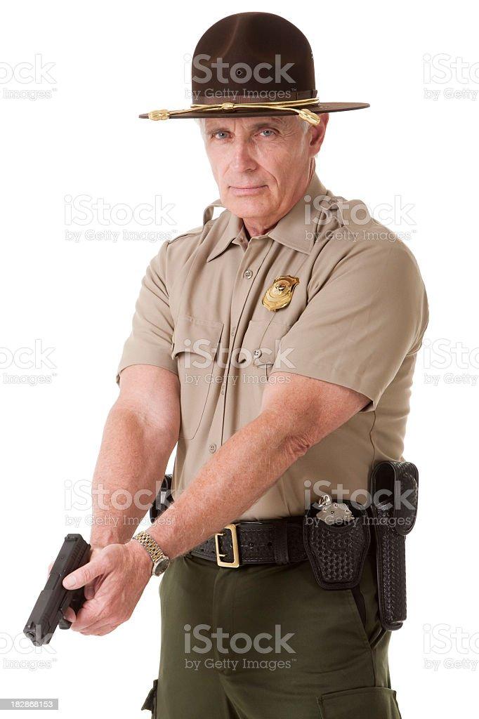Mature Highway Patrolman with Handgun stock photo