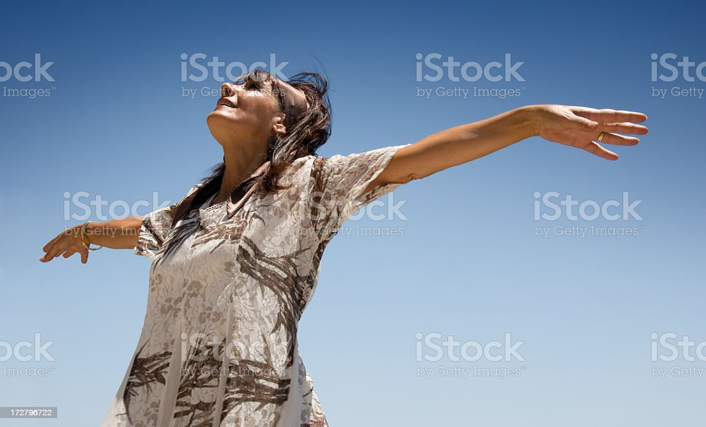 Mature hippie lady spreading her arms royalty-free stock photo