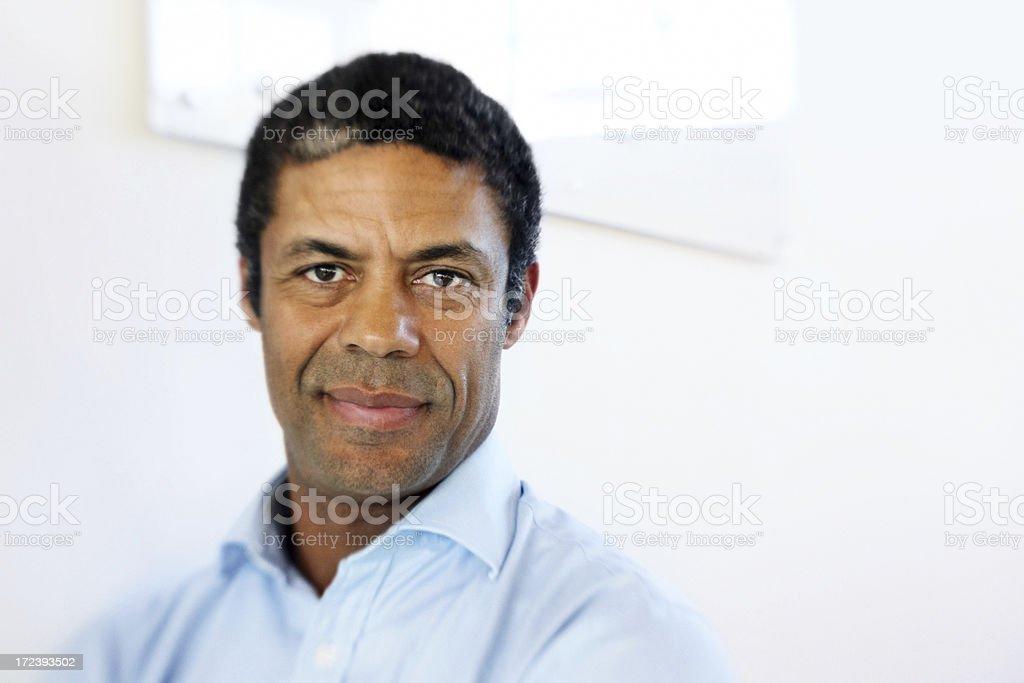 Mature Hispanic businessman looking confident royalty-free stock photo