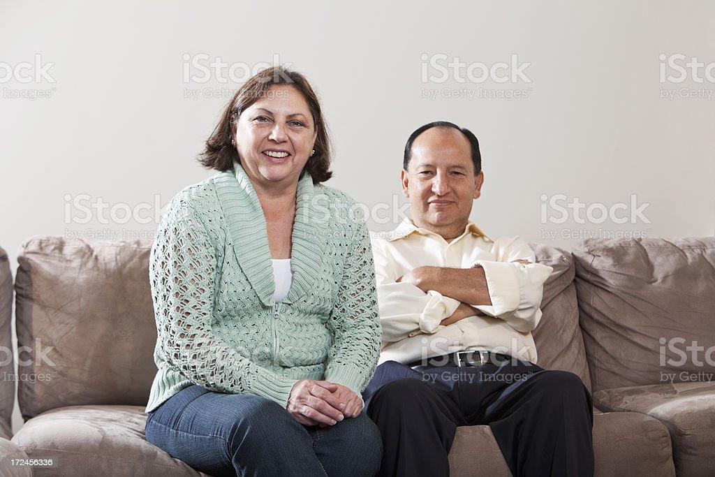 Mature Hispanic couple on sofa royalty-free stock photo