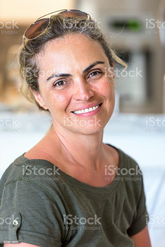 Mature hispanic woman smiling stock photo