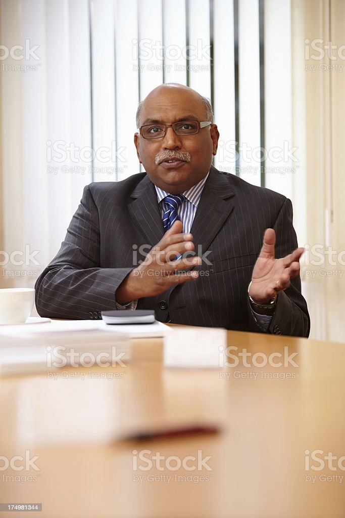 Mature Indian businessman explaining a business plan royalty-free stock photo