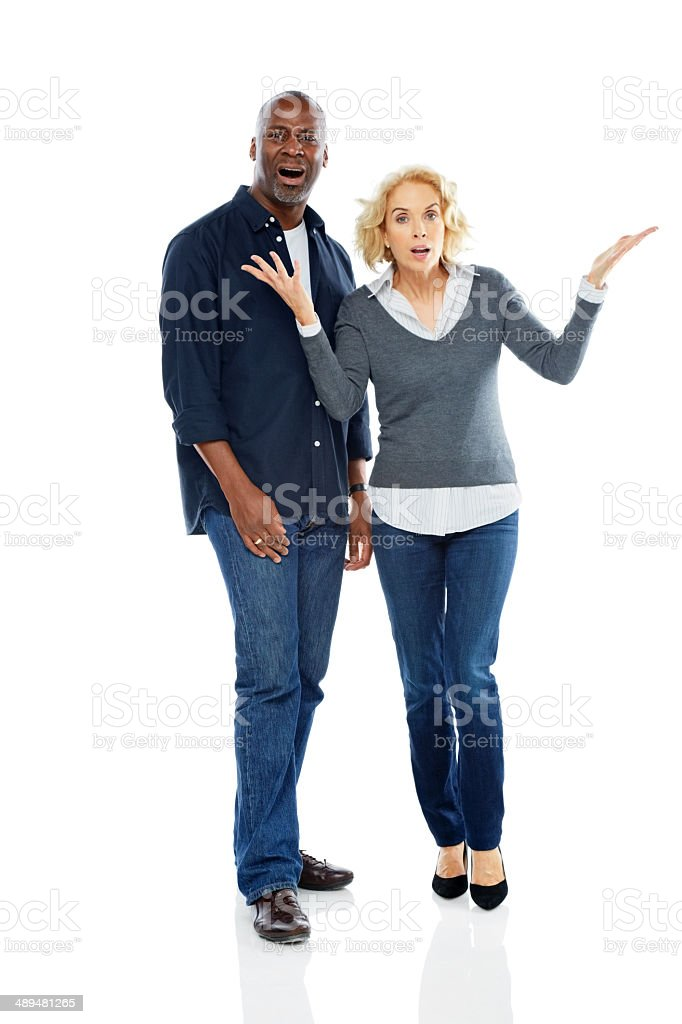 Mature interracial couple looking annoyed stock photo