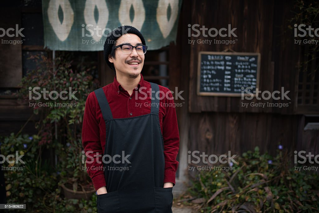 Mature Japanese male coffee shop worker stock photo