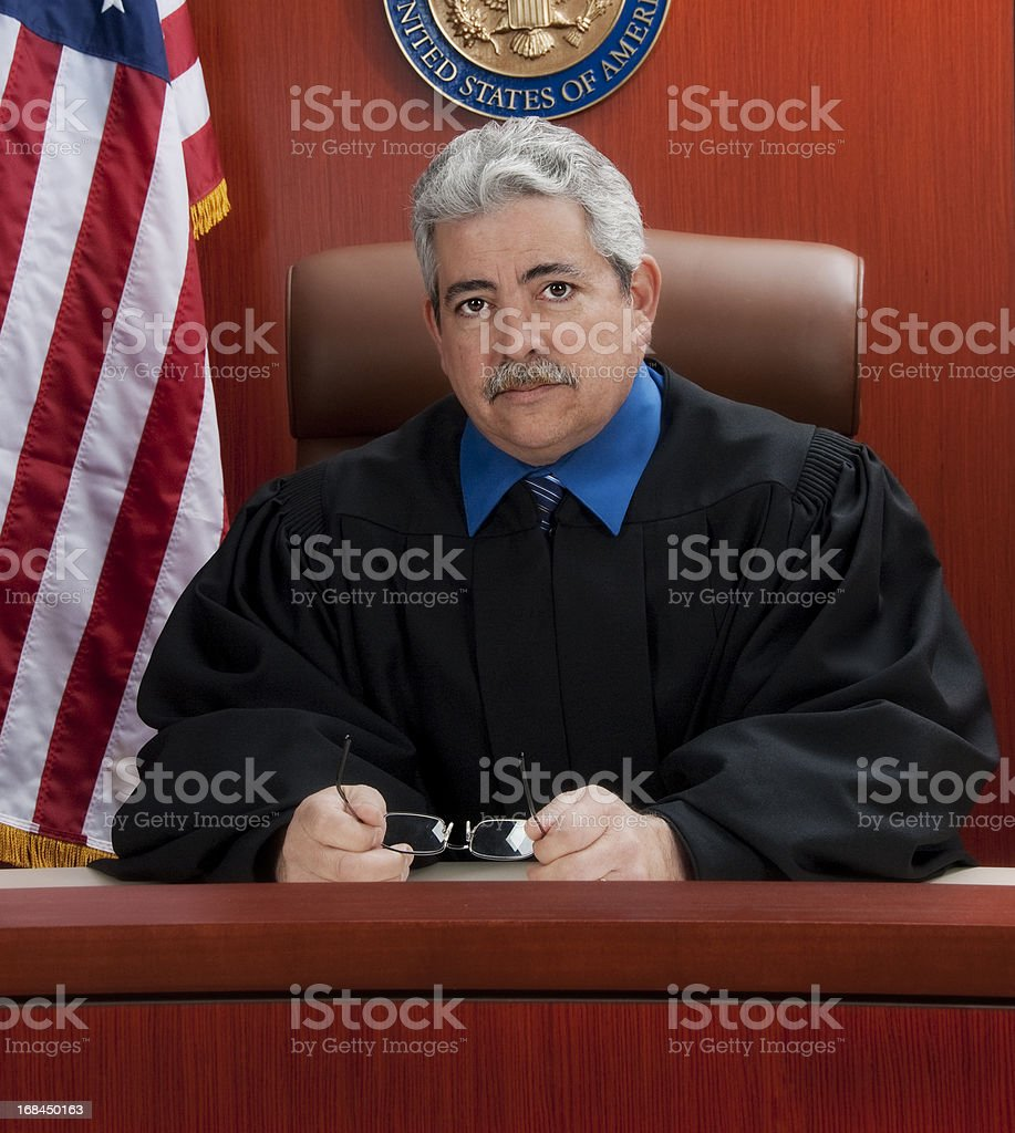 Mature judge at the bench with a serious look stock photo
