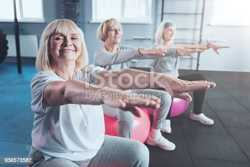 936573360 istock photo Mature ladies enjoying training session at gym 936573582