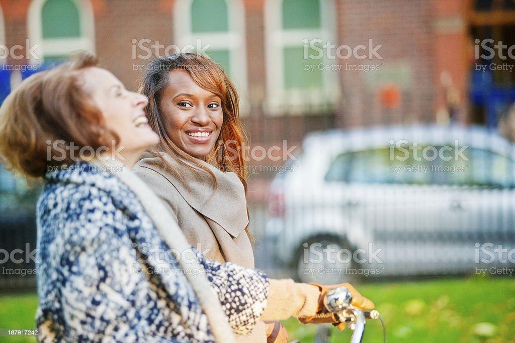 Mature lady and coloured woman promenading. royalty-free stock photo