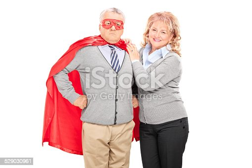 516318379istockphoto Mature lady posing next to her superhero husband 529030961