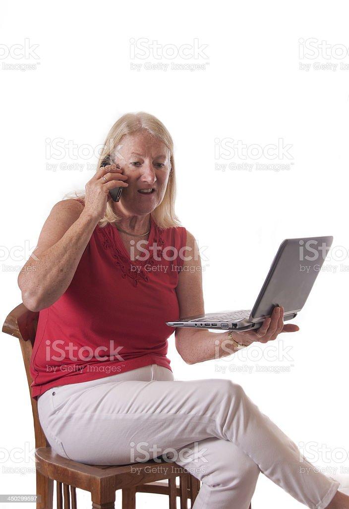Mature lady using modern technology royalty-free stock photo