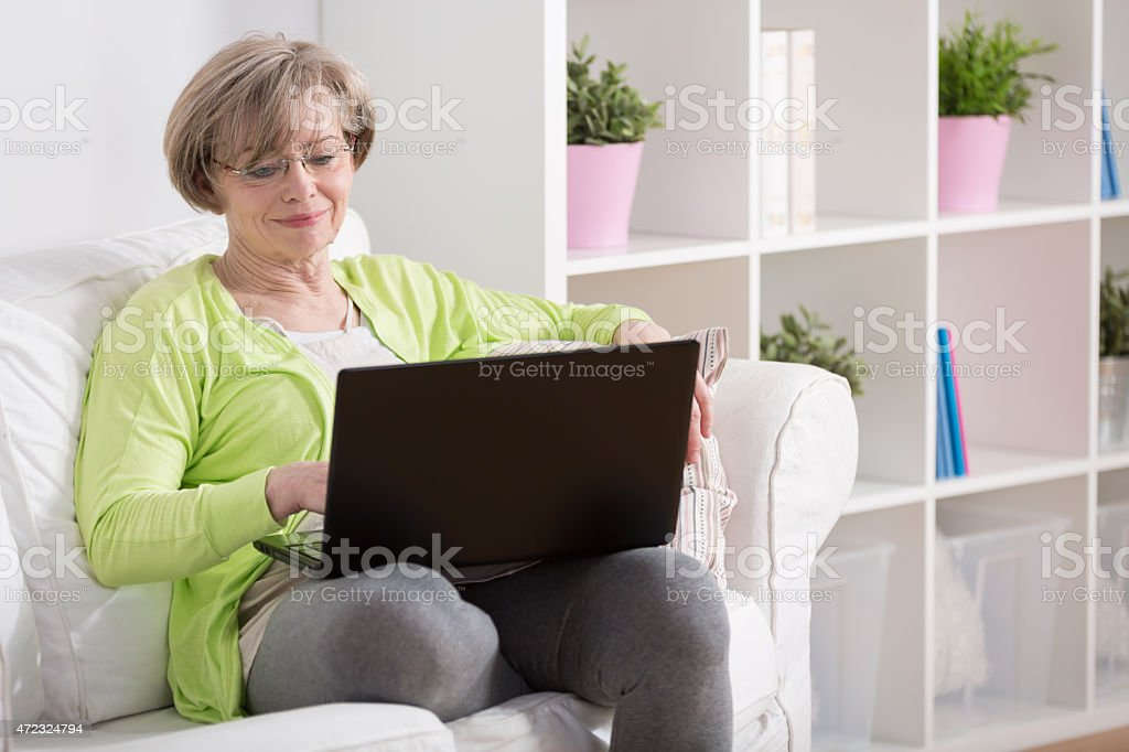 Mature lady with laptop stock photo