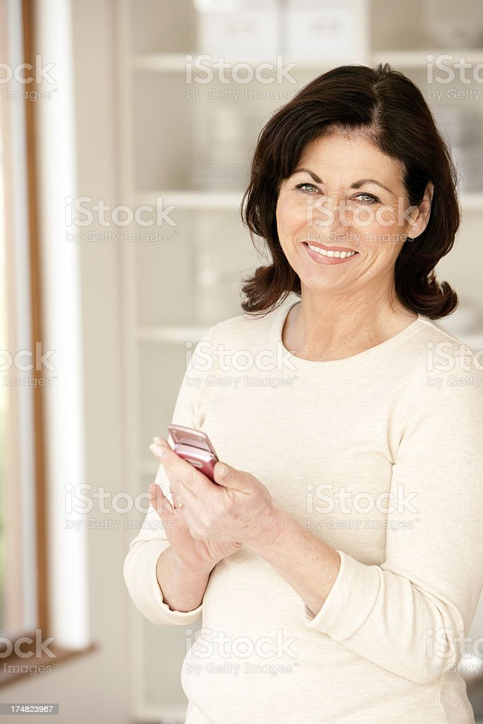 Mature lady with Mobile Phone royalty-free stock photo