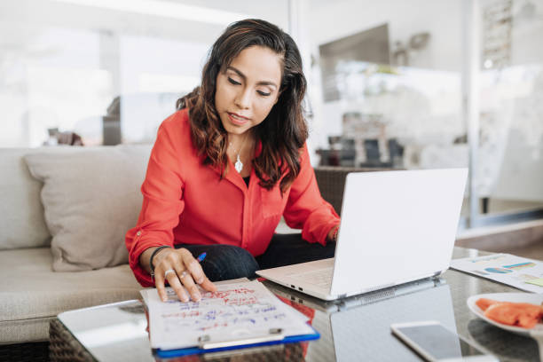 Mature Latin American businesswoman working from home stock photo