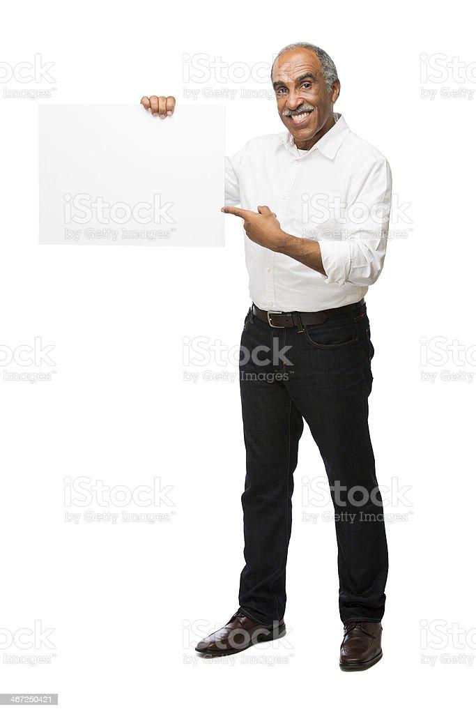 Mature latin man holding sign royalty-free stock photo