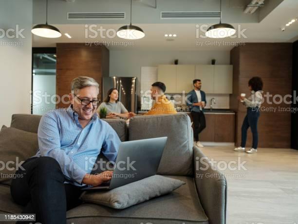 Mature latin man using laptop in lunch room and smiling picture id1185430942?b=1&k=6&m=1185430942&s=612x612&h=hq4tywz5nad59 9wi88jb fpy60w07xo3vwx8hklhja=