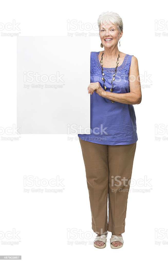 Mature Latin Woman Holding Sign And Smiling Stock Photo - Download Image Now - Istock-6293