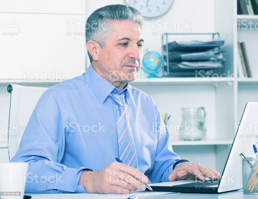 Mature lawyer preparing documents royalty-free stock photo