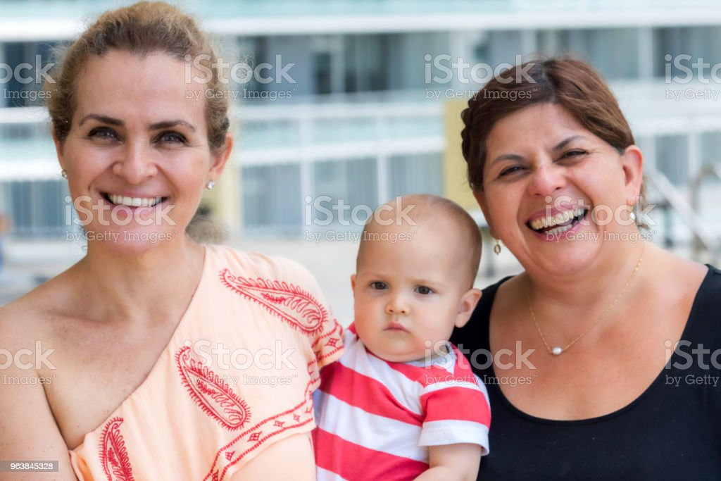 Mature Lesbian Couple Posing With Their Baby Stock Image