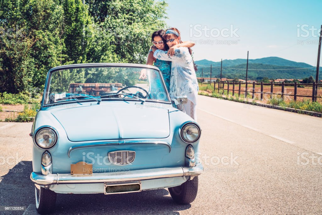 Mature Lesbian Couple Standing By Oldfashioned Car Stock Photo  More Pictures Of -2196