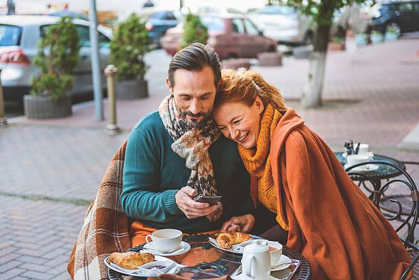 mature loving couple drinking tea outdoors - middle aged man dating bildbanksfoton och bilder