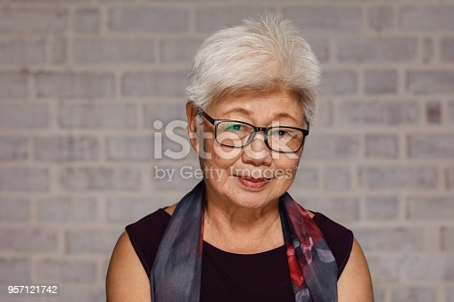 Mature Malaysian Woman photographed in studio