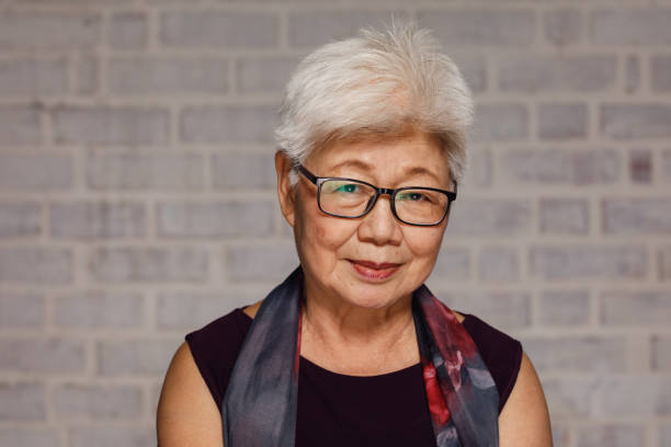 mature malaysian woman - east asian ethnicity stock photos and pictures