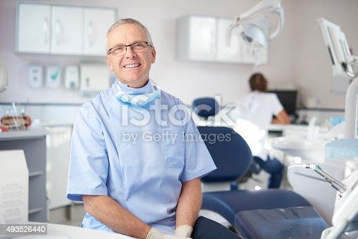 istock mature male dentist portrait 493526440