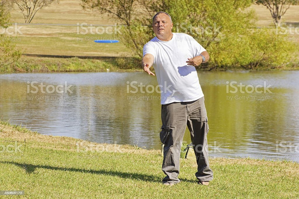 Mature male keeping active with disc golf. stock photo