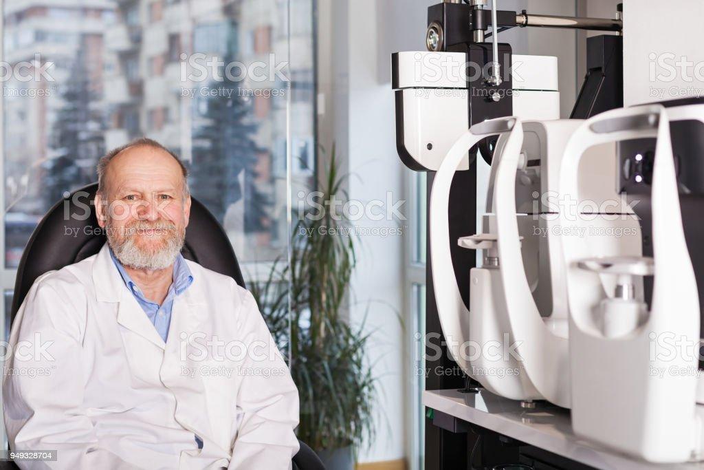 Mature male ophthalmologist stock photo